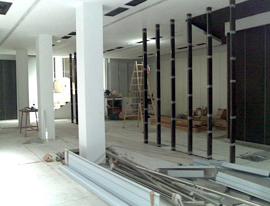 Reforma integral de edificio. Transformación de cine en galería comercial. equipo aparejador 01